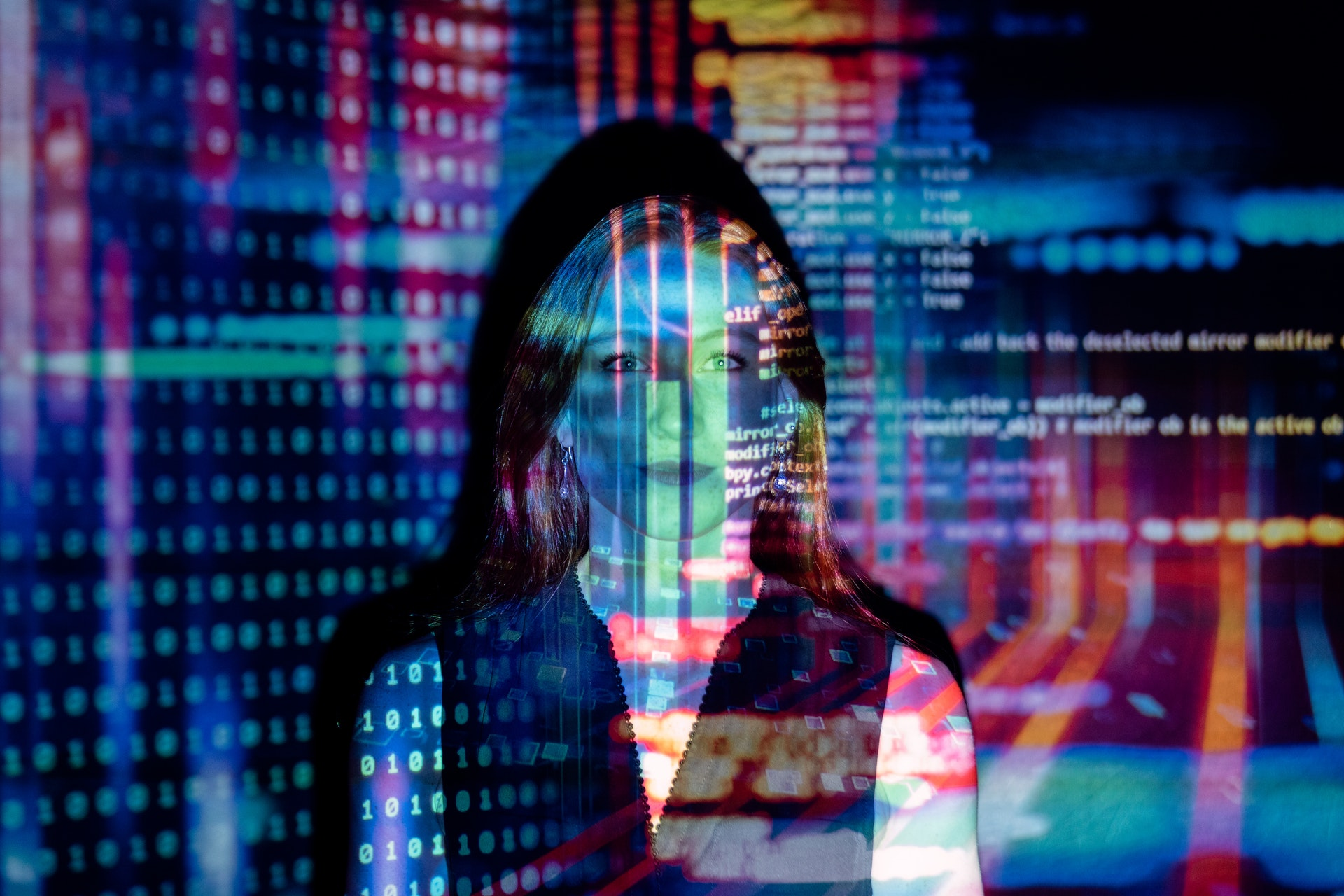 sourcing the best startups - woman behind code projection