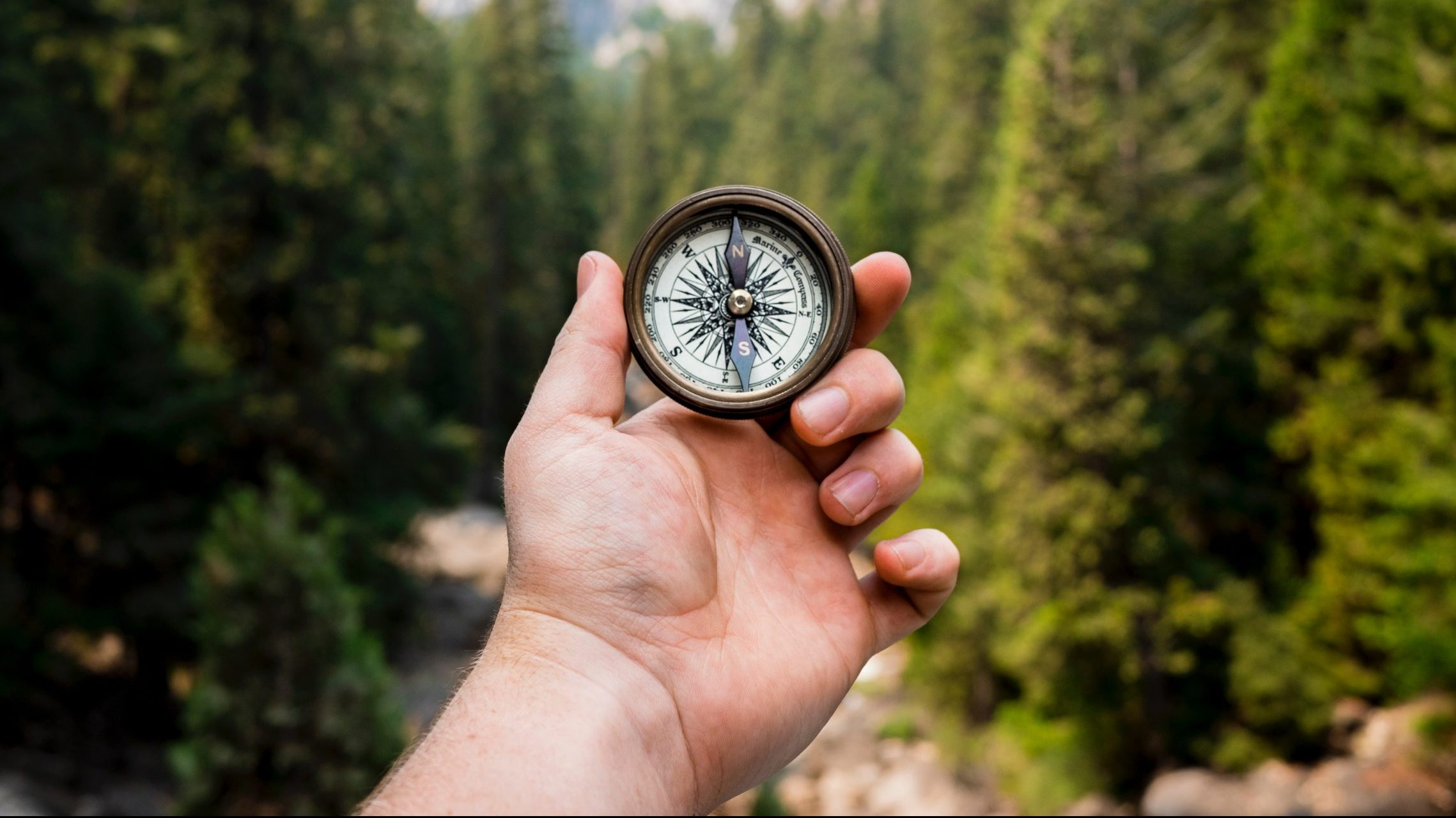 hand using compass - best startup valuation method